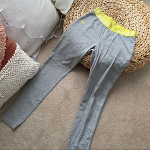 Under armour grey leggings with yellow waistband